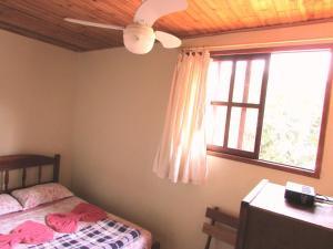 Cama ou camas em um quarto em Pousada Tatu Feliz