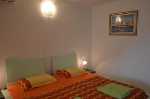 Posteľ alebo postele v izbe v ubytovaní Apartments Tiho