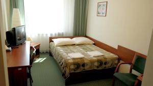 Posteľ alebo postele v izbe v ubytovaní Hostel Krakowiak