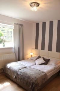Łóżko lub łóżka w pokoju w obiekcie Morski Relax