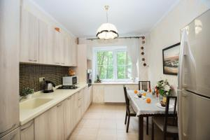 Кухня или мини-кухня в Sunny Svetlogorsk 5
