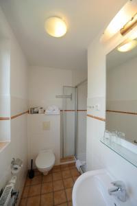 Ein Badezimmer in der Unterkunft Gästehaus Südheide