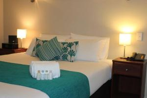 A bed or beds in a room at 540 on Great South Motel