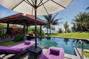 A piscina localizada em Anantara Mui Ne Resort ou nos arredores