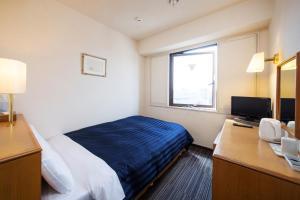 Tempat tidur dalam kamar di Kyoto Plaza Hotel