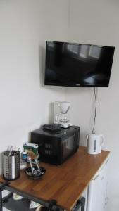 A television and/or entertainment center at Excellent Rooms Amsterdam