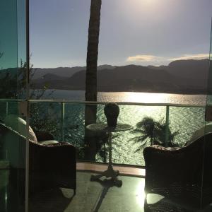 Uma varanda ou terraço em Suites na Casa da Praia