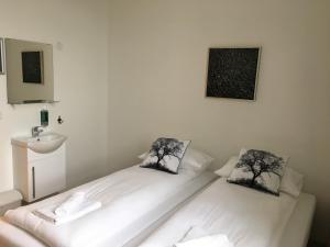 A bed or beds in a room at Welcome Riverside Guesthouse