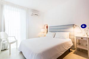 Łóżko lub łóżka w pokoju w obiekcie Casa Catalina Mallorca Sea Front