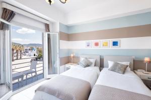 Cama o camas de una habitación en Hotel Oasis