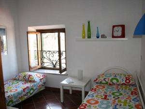 A bed or beds in a room at Greggi Casa Vacanze