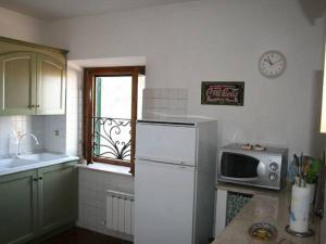 A kitchen or kitchenette at Greggi Casa Vacanze