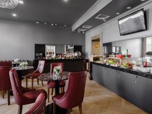 מסעדה או מקום אחר לאכול בו ב-UNO Design Hotel