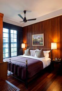 A bed or beds in a room at Bangkok Publishing Residence