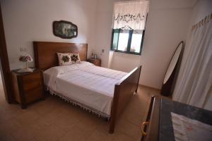 Letto o letti in una camera di Villa Gelsomino