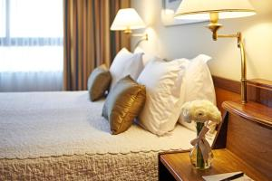 A bed or beds in a room at Maksoud Plaza Hotel Distributed by Accorhotels