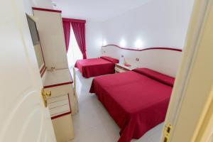 Letto o letti in una camera di Nelson Hotel