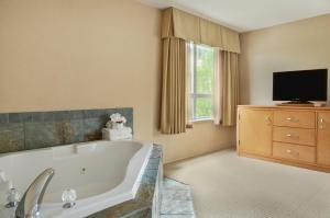 A television and/or entertainment center at Ramada by Wyndham Nanaimo