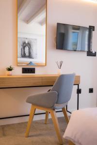 TV o dispositivi per l'intrattenimento presso Bova Luxury Rooms