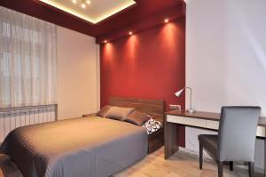 Łóżko lub łóżka w pokoju w obiekcie Apartament Retoryka WAWELOFTS