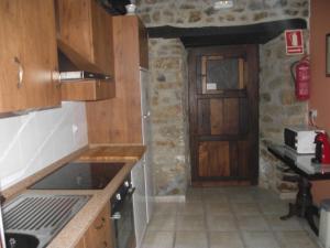 A kitchen or kitchenette at Casa Rural Bentazar