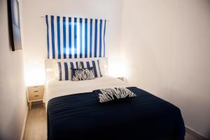 A bed or beds in a room at Apartamento do Atlantico