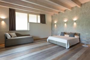 Letto o letti in una camera di Il Sambuco Innamorato