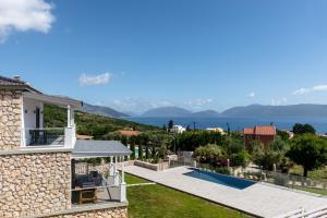 The swimming pool at or near White Villas Karavomilos