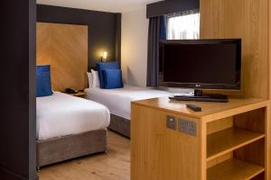 A television and/or entertainment center at Roomzzz Leeds City West