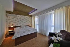 A bed or beds in a room at Hotel Šariš