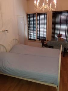 Een bed of bedden in een kamer bij Pension Tivoli