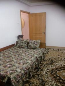 Кровать или кровати в номере Apartment on Gubina