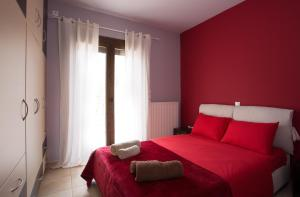Ένα ή περισσότερα κρεβάτια σε δωμάτιο στο Myriam Spa & Luxury Suites