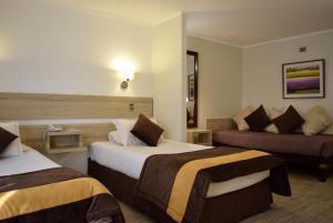 Cama o camas de una habitación en Apart Hotel Cambiaso