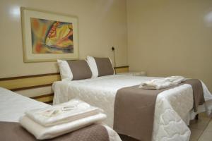 Кровать или кровати в номере Domus Hotel - Veneza