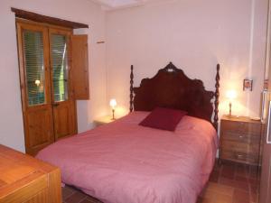 Una cama o camas en una habitación de Cal Son