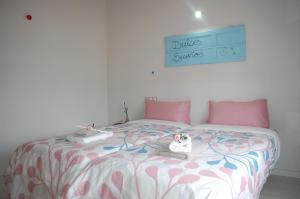 Cama o camas de una habitación en Apartamentos La Harinera
