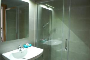 Un baño de Apartamentos La Harinera