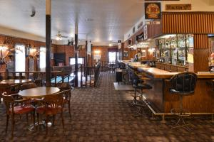 A restaurant or other place to eat at Canada's Best Value Inn – Downtown Hotel Dawson City