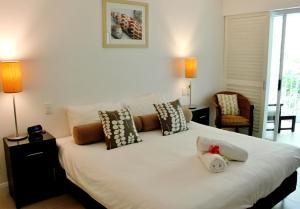 A bed or beds in a room at 6421 BEACH CLUB