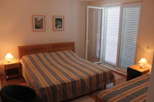 Krevet ili kreveti u jedinici u objektu Bed & Breakfast Dora