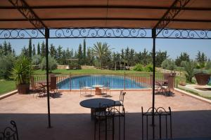 A view of the pool at Riad le Ksar de Fes or nearby