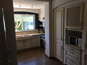 Een keuken of kitchenette bij Clalou