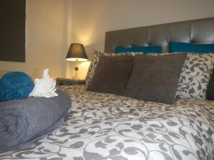 Letto o letti in una camera di Rooms Reducto
