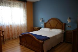 A bed or beds in a room at O Curruncho dos Lopez