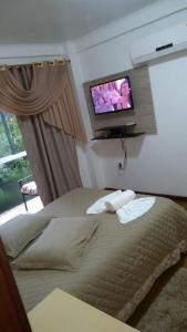 Cama ou camas em um quarto em Residência Mengue