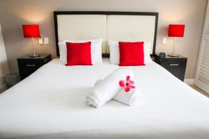 """A bed or beds in a room at 3121 """"SHILOH"""" AT THE BEACH CLUB"""