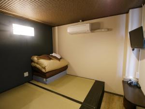 A bed or beds in a room at Fukuoka Hana Hostel