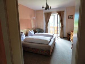 Ein Bett oder Betten in einem Zimmer der Unterkunft Bäckeralm© - B&B 16 +