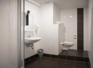 Ванная комната в Hotel De Zeven Heuvelen